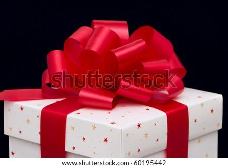 White gift box isolated on black - stock photo