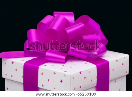 White gift box isolated on black