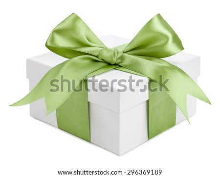 White gift box with green bow isolated. - stock photo