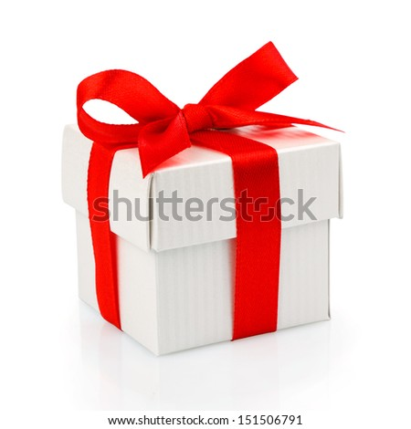white gift box with red ribbon and bow isolated on white with clipping path