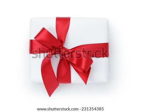 white gift box with ribbon bow from above, white background
