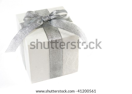 white gift box with silver bow and ribbon isolated over white - stock photo