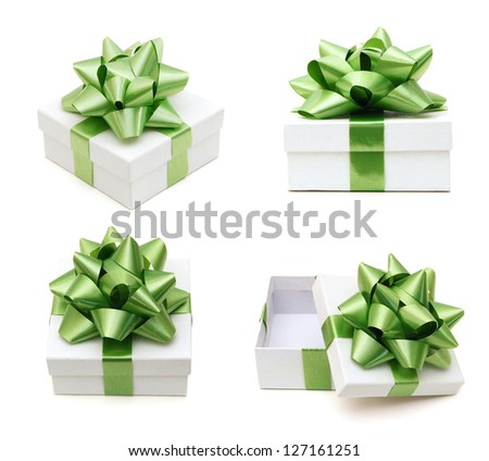 White gift boxes with a blue bow on white background - stock photo