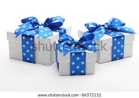 White gift boxes with blue ribbon. - stock photo