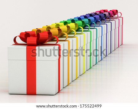 white gift boxes with varicolored ribbon on a white background