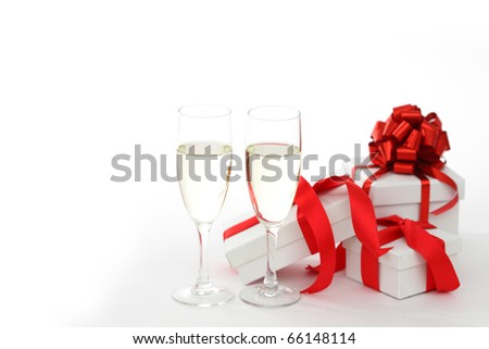white gift with red ribbon
