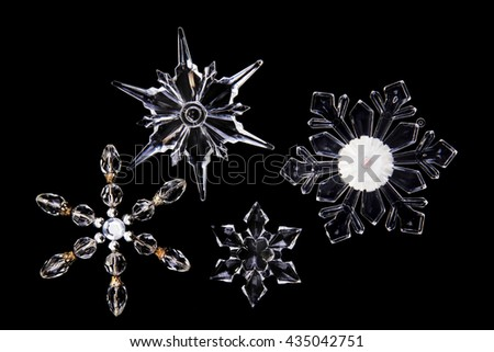 white glass snowflakes isolated on the black background - stock photo