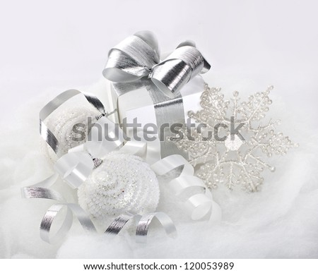 White glittering Christmas decorations with balls, snowflake and present