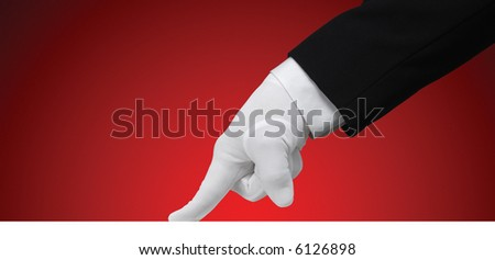 White glove running a finger across a white edge against a red background, isolated with a clipping path - stock photo