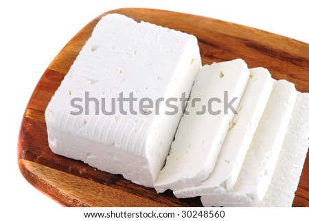 white goat cheese block on wooden board