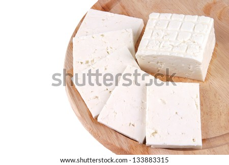 white goat cheese served on wooden plate - stock photo