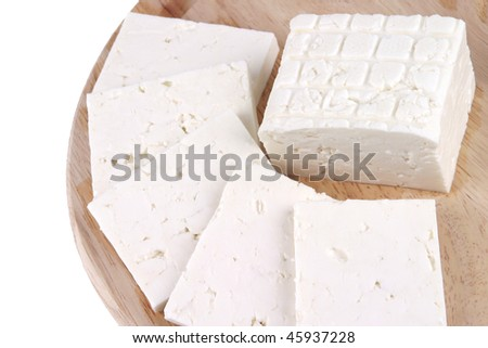 white goat cheese served on wooden plate