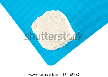 white goat soft cheese on board over white - stock photo