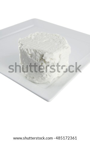 white goat soft cheese on board over white