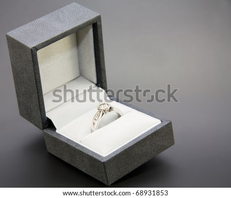 White Gold and Diamond Engagement Ring in a black and white box