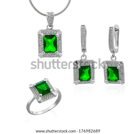 White gold beautiful set with emerald gems on a white background - stock photo
