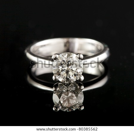 white gold engagement ring with brilliant - stock photo