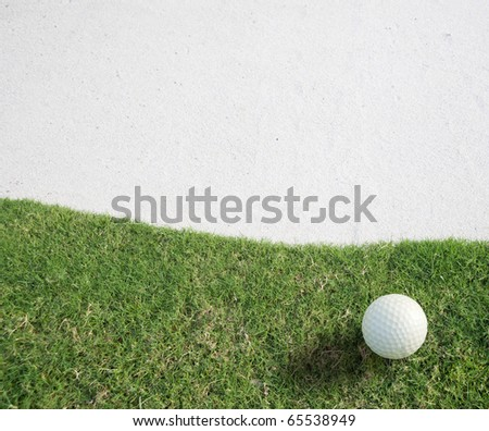 white Golf ball on green grass left side background ,,Golf sport is Balance of Yin Yang.Paste the text into the space  right hand side