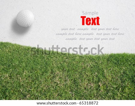 white Golf ball on the white sand Near green grass background ,Golf sport is Balance of Yin Yang.copy space left and right for adding text.
