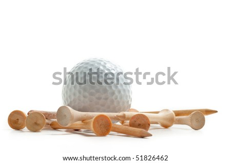 White golf ball with many wooden tee around it.