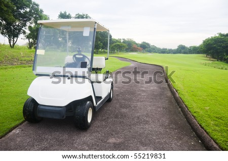 White golf cart in a golf course in the Philippines