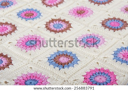 White granny square blanket in pink, blue and brown - stock photo