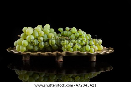 White grapes on a black background