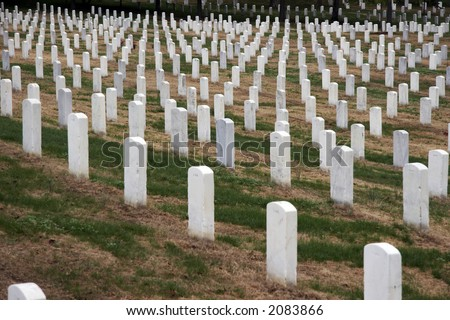 White gravestones in a row on Arlington National Cemetery, Washington DC, USA