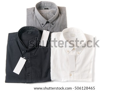 white, gray and black shirt with blank price tag isolated on white background