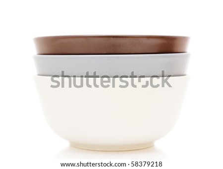 white, gray and brown ceramic plates isolated on white