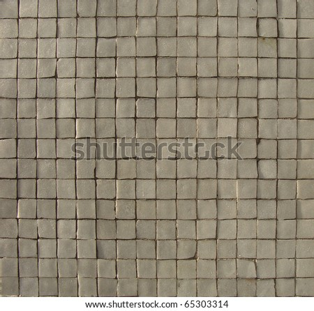 white gray mosaic pattern on a wall with some depth - stock photo