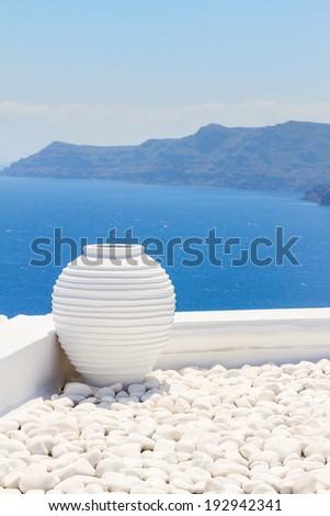 white greek amfora against volcano caldera, beautiful details of Santorini island, Greece - stock photo