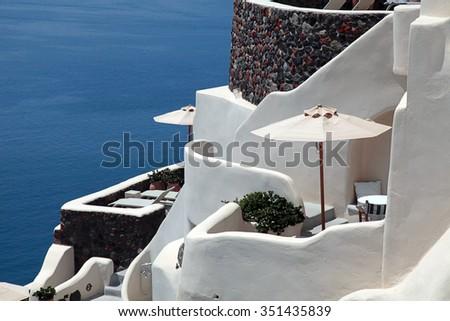 White greek balcony resort house and Aegean sea in Oia, Santorini island, Greece. Selective focus - stock photo