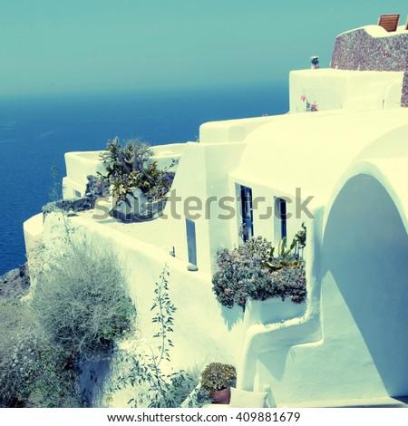 White greek resort house and Aegean sea in Oia, Santorini island, Greece. square vintage toned image, instagram effect - stock photo