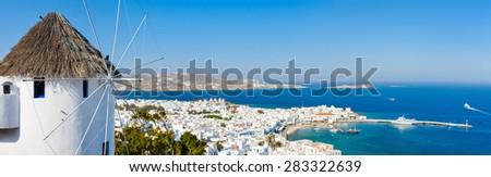 White greek windmill overlooking traditional village on Mykonos Island, Greece, Europe - stock photo