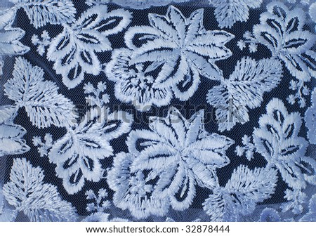 White guipure, embroidery on cloth - texture, design element - stock photo