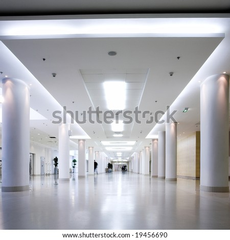 White hall of office centre, people move - stock photo