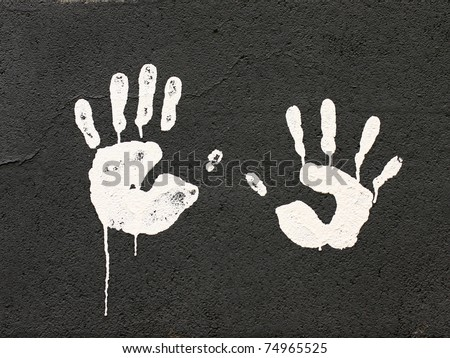 White hands on black wall - stock photo