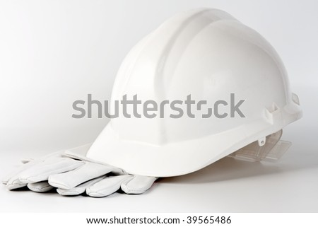 white hard hat and protection gloves on background - stock photo