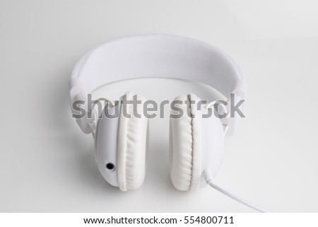white headphone device isolated on a white background for music companies.