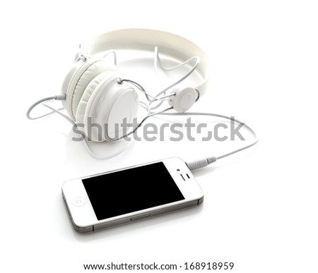 White headphones with mobile smartphone - stock photo