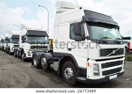 White Heads of Semitrailer Trucks - stock photo