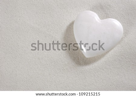 white heart in white sand