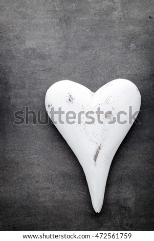 White heart on the gray metal background.