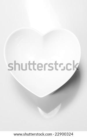 White heart on white ground - stock photo