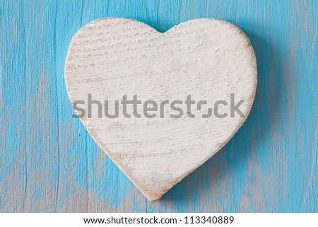 white heart shape on wooden board - stock photo