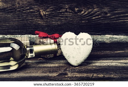 White Heart With Drops Of Rain, Bottle Of White Wine And Gift Boxes On Wooden Board. Love Concept In Vintage Style. Valentines Day Background. - stock photo