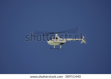 White helicopter with blue sky