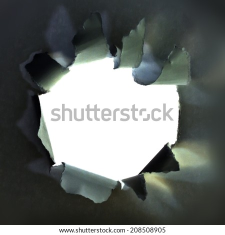 white hole in black paper.  - stock photo