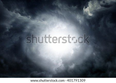 White Hole in the Dark Storm Clouds - stock photo